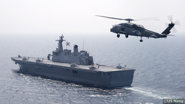 A U.S. Marine Corps MV-22B Osprey tiltrotor aircraft made its first ever landing on the flight deck of a Republic of Korea Navy amphibious assault ship off the coast of the Korean peninsula, March 26, 2015. The Osprey departed from the USS Bonhomme Richard (LHD 6) nearby and landed on the ROK ship Dokdo (LPH-6111).