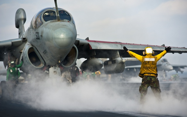 An EA-6B Prowler is about to launch from a US Navy Carrier with AN/ALQ-99 Low Band Transmitters