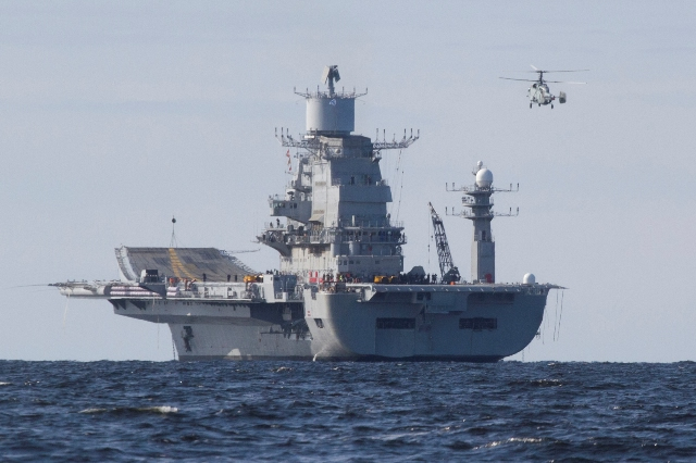 A Russian-built aircraft carrier is to be handed over to the Indian Navy on November 15, and will reach India by February 2014, a senior official at the Russian arms exports monopoly said Wednesday. The Vikramaditya carrier, which is already years past its original 2008 delivery date, was supposed to have been handed over to India in December 2012, but last year's sea trials revealed that the vessel's boilers were not fully functional.