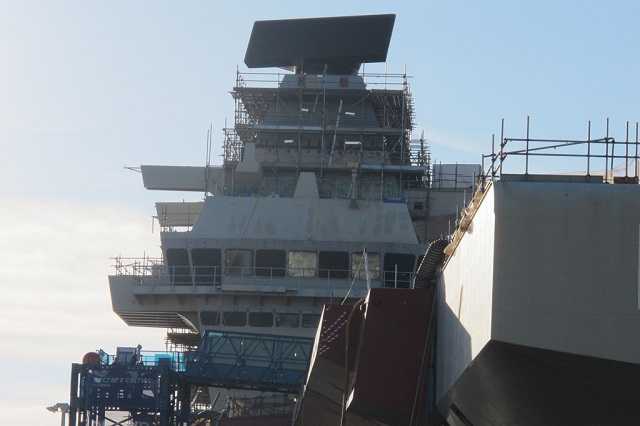 The crew of HMS Queen Elizabeth flashed up the new carrier's 'invisible eyes' as part of ongoing preparations to ready the leviathan for sea next year. The S1850M radar – the same as those fitted to Type 45 and Horizon destroyers – is a large black slab (over eight tonnes, 32 square metres) sitting on top of the carrier's forward island.
