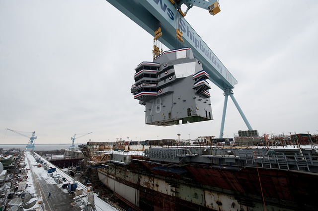 Huntington Ingalls Industries celebrated significant progress on January 26, 2013 as the 555-metric ton island was lowered onto the nuclear-powered aircraft carrier Gerald R. Ford (CVN 78) at the company's Newport News Shipbuilding (NNS) division. The island will serve as the command center for flight deck operations aboard the first of the next-generation class of aircraft carriers.