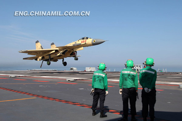 "Multiple batches of ship-borne J-15 fighters conducted take-off and landing training on China's first aircraft carrier ""Liaoning Ship"", which was first launched for scientific research experiments and training this year, on June 19, 2013 in a sea area of the Bohai Sea. This is another take-off and landing training by ship-borne J-15 fighters on the ""Liaoning Ship"" after the J-15 fighters successfully landed on and took off from the deck of the aircraft carrier for the first time in November 2012."