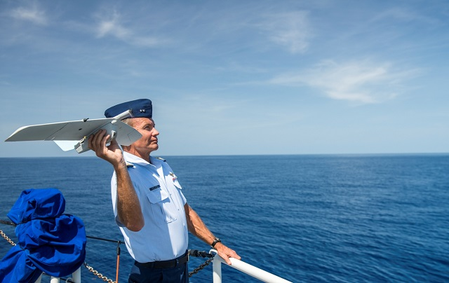 Rear Adm. John Korn, commander of the 7th Coast Guard District, launches an unmanned aircraft system during a testing phase onboard the Coast Guard Cutter Richard Etheridge. U.S. Coast Guard photo by Petty Officer 2nd Class Luke Clayton.