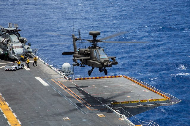 AH-64E Apache Guardians from 1st Armed Reconnaissance Battalion, 25th Aviation Regiment, 25th Combat Aviation Brigade, 25th Infantry Division, conducted deck landing qualifications aboard the amphibious assault ship USS Peleliu (LHA 5) off the coast of Hawaii, July 19, as part of the Navy's Rim of the Pacific Exercise 2014.