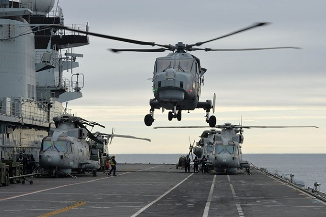 The Royal Navy's new helicopter has paid its first visit to HMS Illustrious – dropping in on the veteran carrier during a submarine hunting exercise off Cornwall. Wildcat, which will replace the long-serving Lynx on the front line from next year, touched down on Lusty in the middle of Exercise Deep Blue.