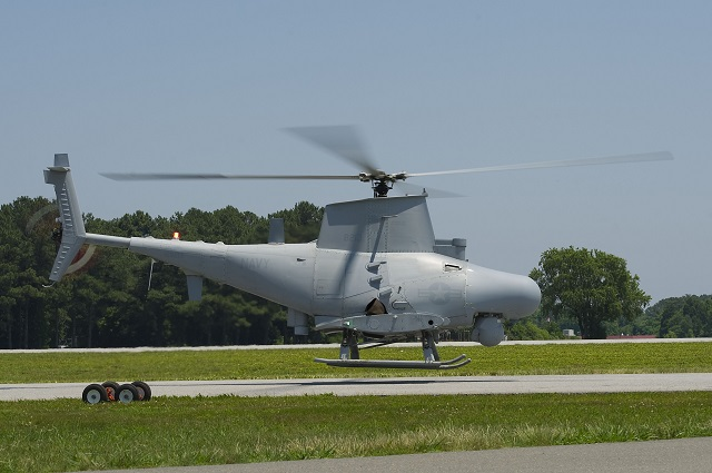The MQ-8 Fire Scout prepares to land after its first flight with a new maritime surface search radar June 16 at Webster Field Annex, Md. This upgrade will increase the situational awareness and threat warning in a high-traffic littoral environment. Fire Scout's deployment with the new radar is planned for 2015. (Photo Courtesy of U.S. Navy)