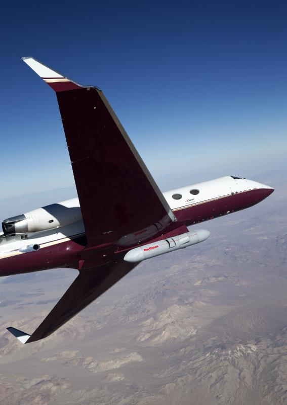 An early version of Raytheon's Next Generation Jammer pod flies on a Gulfstream test bed over the range at Air Naval Station China Lake during a flight test on October 16th. The test was conducted to prove out the maturity of critical technologies in a representative environment against real-world threats. (PRNewsFoto/Raytheon Company)