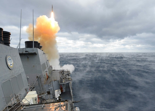ATLANTIC OCEAN (Feb. 6, 2015) The Arleigh Burke-class guided-missile destroyer USS Laboon (DDG 58) launches an SM-2 missile during a training exercise. Laboon is underway for a composite training unit exercise (COMPTUEX) with the Theodore Roosevelt Carrier Strike Group in preparation for an upcoming scheduled deployment. (U.S. Navy photo by Mass Communication Specialist 3rd Class Michael J. Lieberknecht/Released)