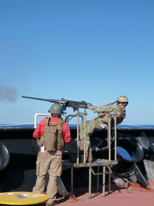 Members of the EST test the range of motion of the installed weapons mount.