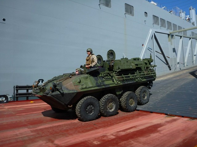 During offload operations held as part of the Initial Operational Test and Evaluation (IOT&E) end-to-end event, a Light Armored Vehicle-Logistics (LAV-L) completes its transit off of the VTR.