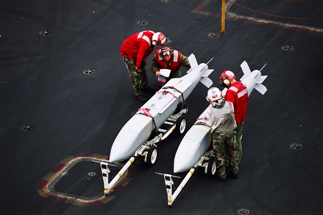 Aviation Ordnancemen assigned to G-1 Division inspect Joint Stand Off Weapons (JSOW) aboard USS Abraham Lincoln (CVN 72) before transferring them to waiting aircraft. Picture: US Navy