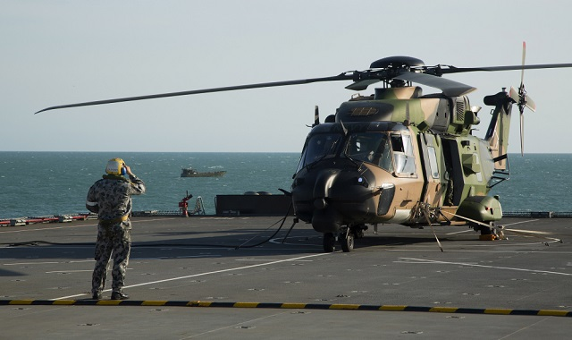 A Royal Australian Navy MRH90 helicopter conducts pre-flight checks before departing HMAS Choules during Exercise Talisman Sabre 2015.