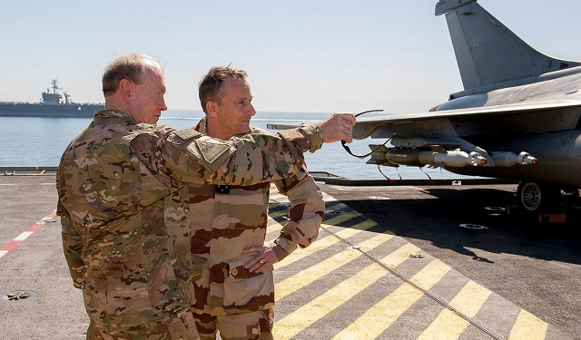US General Martin Dempsey, Chairman of the Joint Chiefs of Staff , with his French counterpart General Pierre de Villiers on-board the Charles de Gaulle. Note USS Carl Vinson in the background. French Navy Picture
