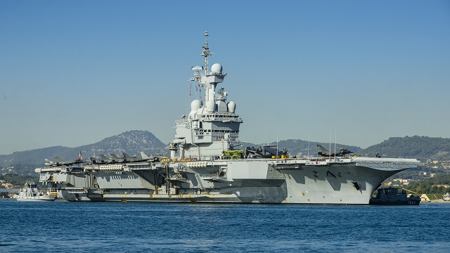 "The French Navy nuclear-powered aircraft carrier (CVN) Charles de Gaulle (R91) leaving Toulon naval base for the ""Arromanches 2"" operational mission. Picture: French Navy"