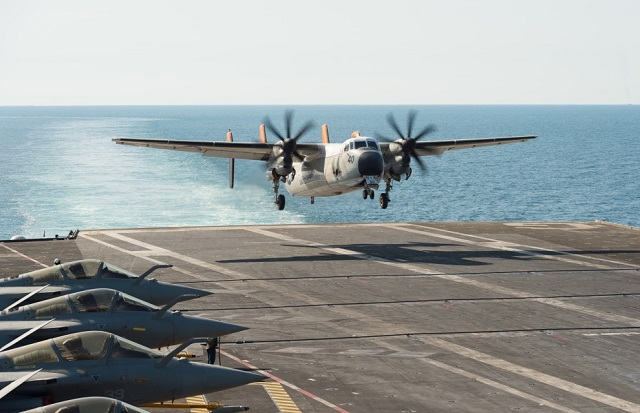 "A US Navy C-2A Greyhound carrier on-board delivery (COD) aircraft from fleet logistic support squadron VRC-40 ""Rawhides"" about to perform a ""touch and go"" with French Navy aircraft carrier Charles de Gaulle. The French CVN is currently deployed in the Gulf in support of coalition operations against Daesh."