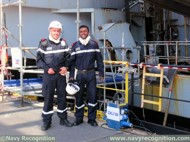 The crew of the aircraft carrier takes part in the mid-life refit operations of their vessl too.