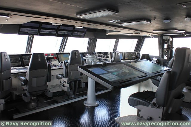View of the bridge aboard RSS Independence, with the very large, collaborative tablets for the Commanding Officer and his XO.