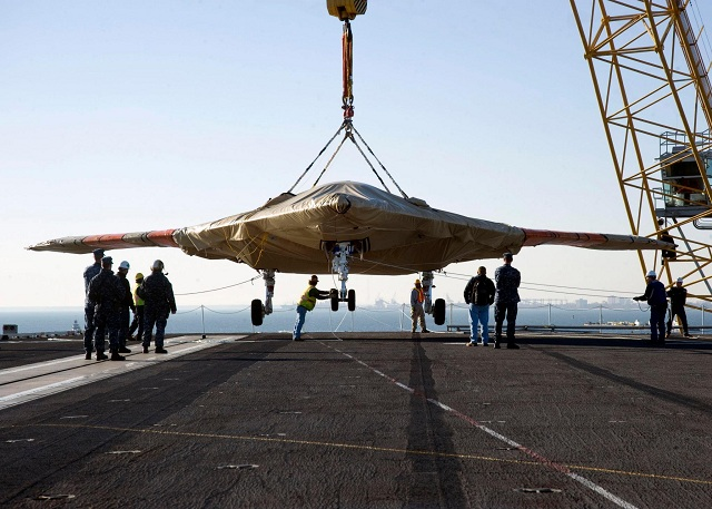 The U.S. Navy hoisted an X-47B Unmanned Combat Air System (UCAS) demonstrator on board aircraft carrier USS Harry S. Truman (CVN 75) Nov. 26, in preparation for an unmanned aircraft's first, carrier-based testing.