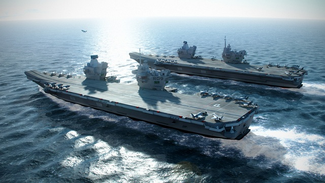 Workers at BAE Systems on moved sunday the biggest section of HMS QUEEN ELIZABETH, the first of two new aircraft carriers for the Royal Navy, out of the company's shipbuilding hall at Govan for the first time.