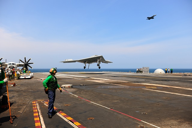 USS GEORGE H. W. BUSH, at sea (NNS) -- The X-47B Unmanned Combat Air System (UCAS) demonstrator completed its first-ever carrier-based arrested landing on board USS George H.W. Bush (CVN 77) off the coast of Virginia July 10.