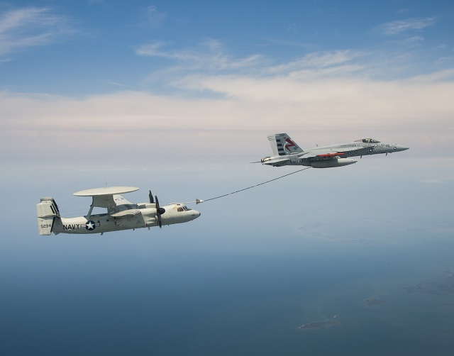 An E-2C performs an aerial refueling flight test with an F/A-18 at NAS Patuxent River. PMA-231 plans to equip the E-2D with this capability to extend its mission endurance. U.S. Navy photo by Liz Wolter