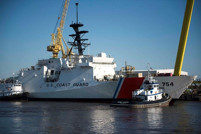 "Huntington Ingalls Industries' Ingalls Shipbuilding division christened the company's fifth U.S. Coast Guard National Security Cutter (NSC), James (WMSL 754), on August 16th in front of nearly 1,000 guests. Charlene James Benoit, great-great niece of the ship's namesake, Capt. Joshua James, is the ship sponsor. At the culmination of the ceremony, Benoit smashed a bottle across the bow of the ship, proclaiming, ""May God bless this ship and all who sail in her."""