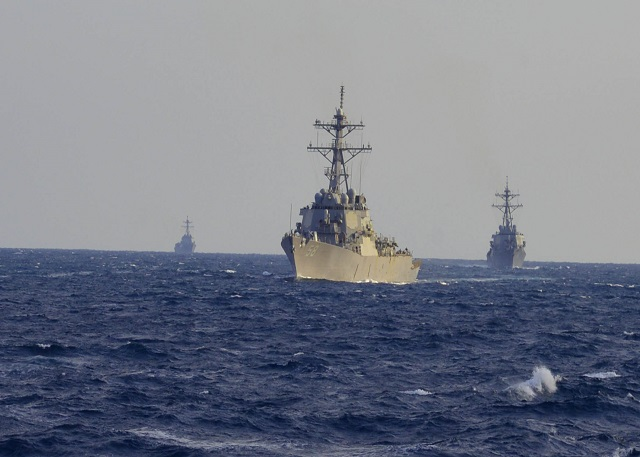 ATLANTIC OCEAN (Jan. 22, 2015) The guided-missile destroyers USS Laboon (DDG 58), USS McFaul (DDG 74), and USS Farragut (DDG 99) conduct a strait transit exercise with the Arleigh Burke-class guided-missile destroyer USS Winston S. Churchill (DDG 81). Churchill is underway conducting a composite training unit exercise with the Theodore Roosevelt Carrier Strike Group in preparation for an upcoming deployment. (U.S. Navy photo by Senior Chief Culinary Specialist Rodney Davidson/Released)