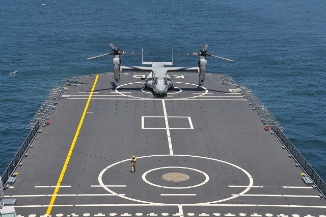 An MV-22 Osprey with Marine Medium Tiltrotor Squadron 261 prepares to land onto the Karel Doorman, a Dutch warship, during an interoperability test near Marine Corps Air Station New River, N.C., June 12, 2015. The unit worked jointly with the Royal Netherlands Navy to perform the first MV-22 Osprey carrier landing aboard a Dutch warship and strengthened the existing partnership between the two countries. Picture: USMC