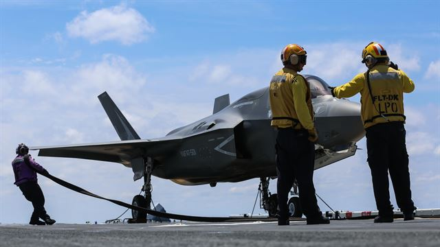 Maintenance is performed on an F-35B Lightning II on the flight deck of USS Wasp (LHD-1) during routine daylight operations, a part of Operational Testing 1, May 22. OT-1 is serving the purpose of evaluating the full spectrum of F-35B measures of suitability and effectiveness, as well as assessing the integration of the aircraft into the spectrum of flight operations. The F-35B is with Marine Fighter Attack Training Squadron 501, Marine Aircraft Group 31, 2nd Marine Aircraft Wing.
