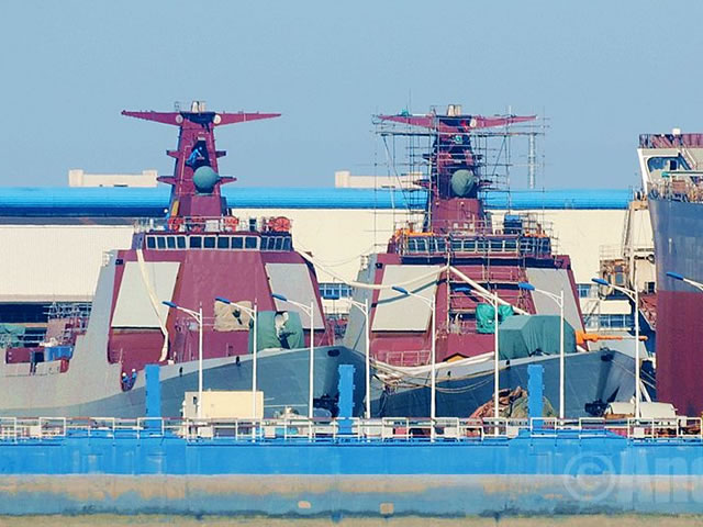 September 2015 picture showing two Type 052D Destroyer hulls in various stages of completion at the Changxing Jiangnan naval shipyard near Shanghai.
