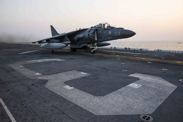 ARABIAN GULF (Nov. 19, 2015) An AV-8B Harrier assigned to Marine Medium Tiltrotor Squadron (VMM) 162 (Reinforced), 26th Marine Expeditionary Unit (26th MEU), launches from the amphibious assault ship USS Kearsarge (LHD 3) to conduct their first missions over Iraq in support of Operation Inherent Resolve. Kearsarge is deployed to the U.S. 5th Fleet, supporting Operation Inherent Resolve, the effort to degrade and ultimately destroy ISIL; maritime security operations; and regional theater security cooperation efforts. (U.S. Navy photo by Mass Communication Specialist Seaman Apprentice Ryre Arciaga/Released)