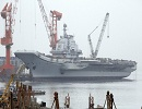 China's first aircraft carrier, the Liaoning, left its homeport of Qingdao in east China's Shandong Province for the South China Sea on Tuesday on a scientific and training mission.